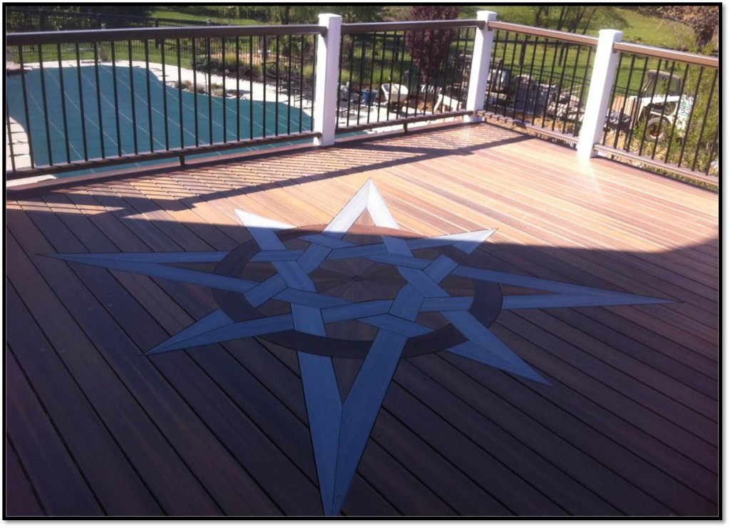 Gorgeous inlaid composite decking eight-pointed star design using Fiberon Horizon decking in Ipe, Castle Gray and Redwood