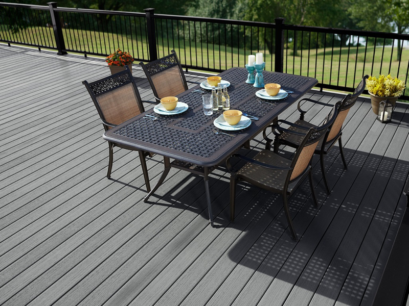 This casually elegant backyard space features Fiberon Paramount PVC Decking in Mineral, one of two solid colors in the collection.