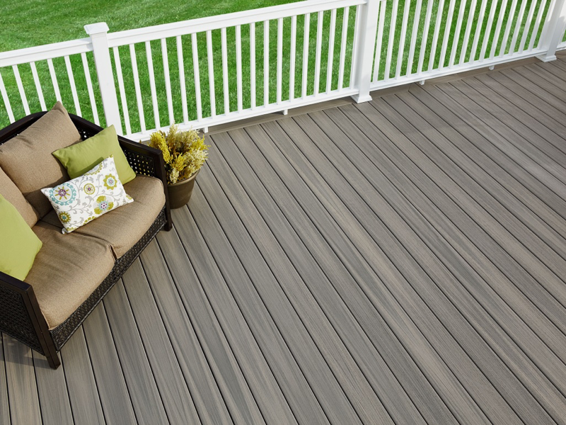 PVC Decking stands up to people, pets, and lots of parties, thanks to its dent-resistant nature. (Shown here: Paramount PVC Decking in Sandstone.)