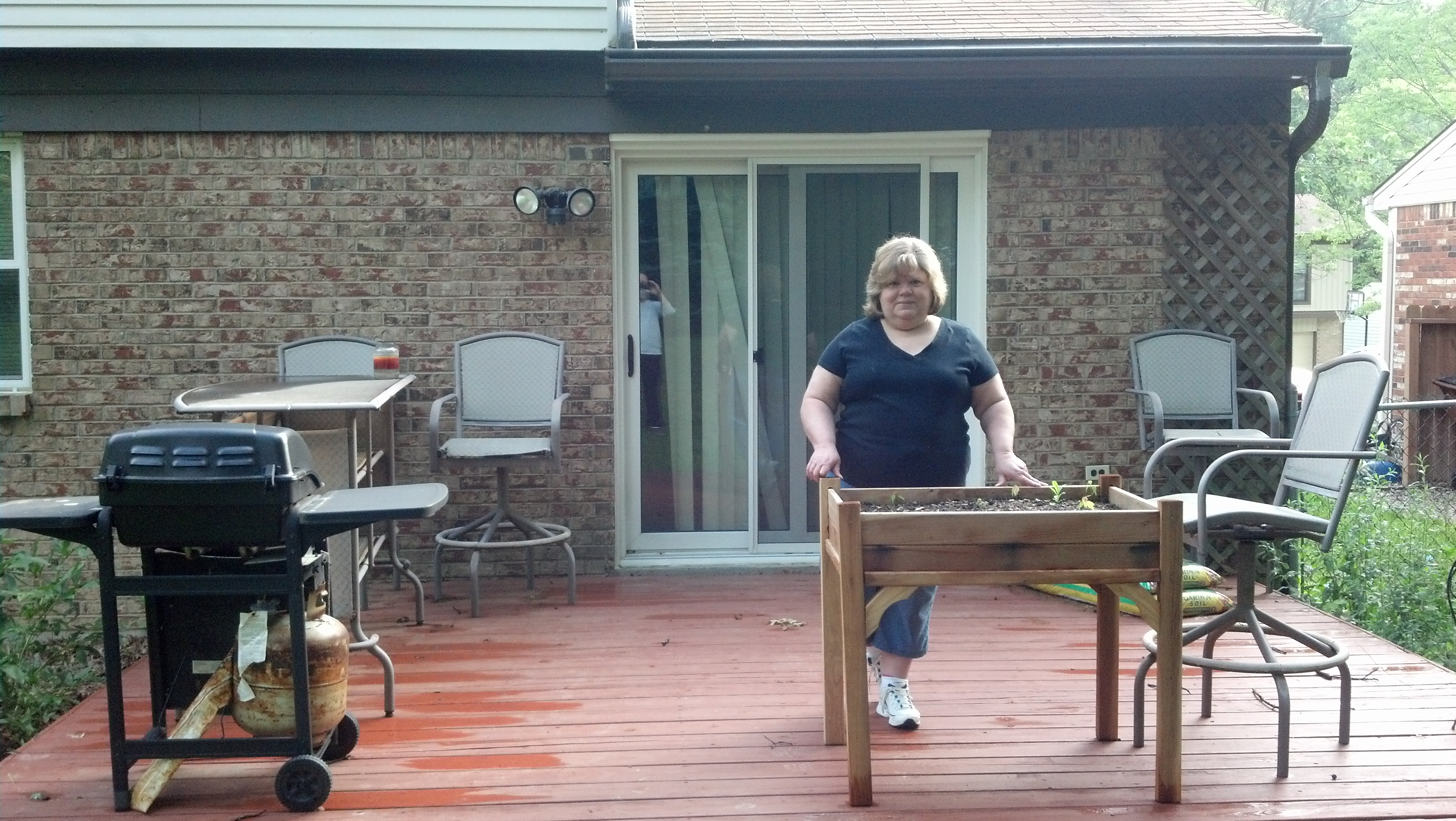 Cynthia on her old deck