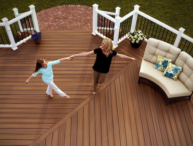 Woman and girl dancing on deck