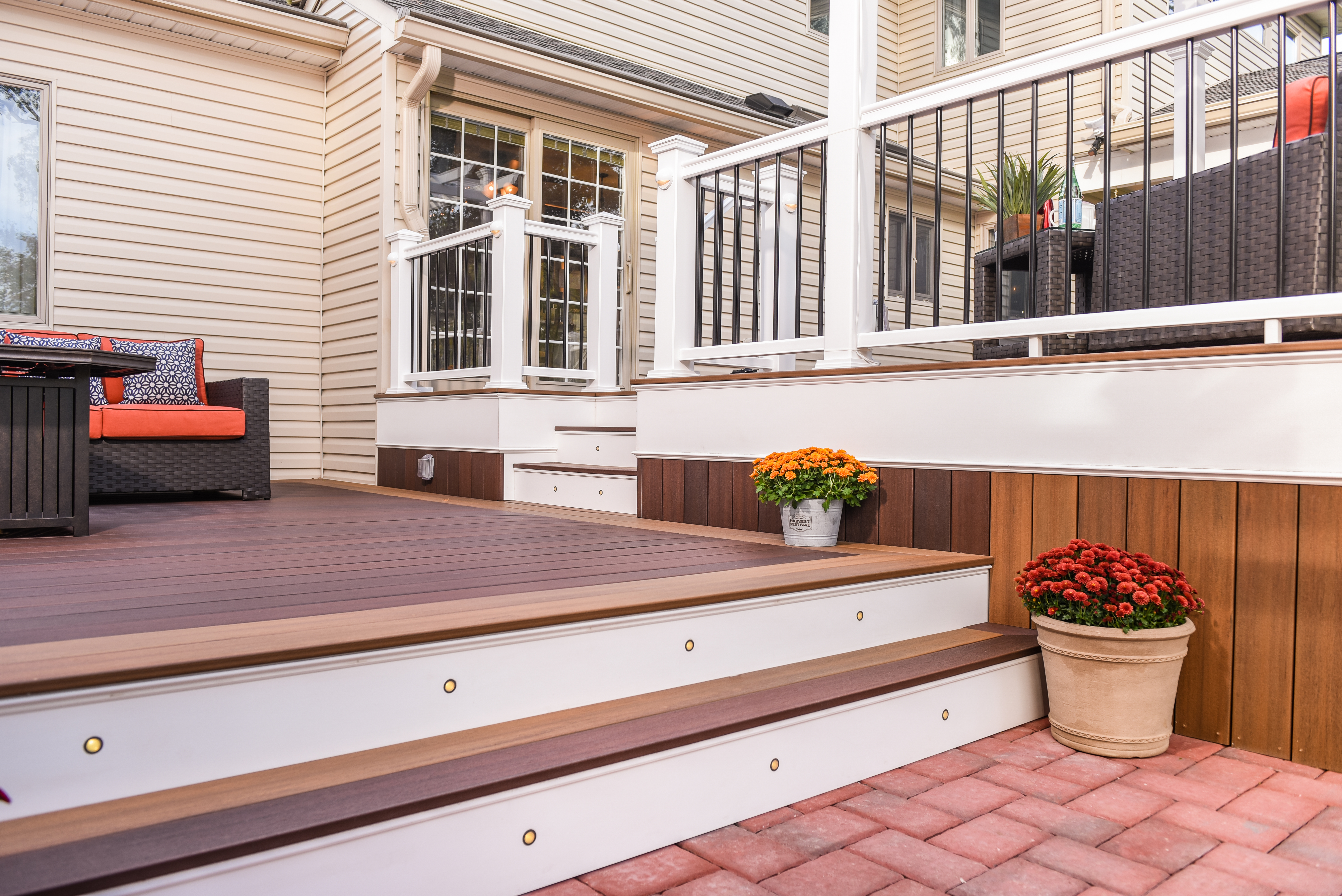 Symmetry Decking in Burnt Umber with Warm Sienna accents, complemented by Symmetry Railing in Tranquil White.